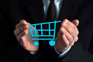 Businessman with a shopping cart symbol