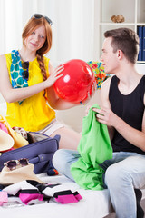 Couple during travel preparation