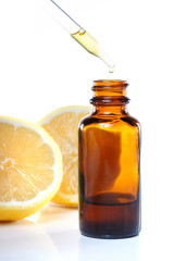 Herbal medicine dropper bottle with lemons