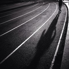 silhouette man running on track