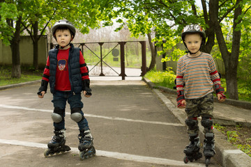 Two small boys kitted out for roller skating