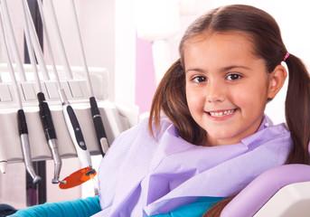 cute little girl in dental chair waiting for dentist