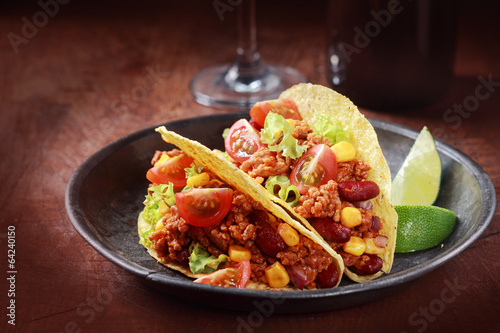 Tex-mex cuisine with corn tacos with meat - 64240150