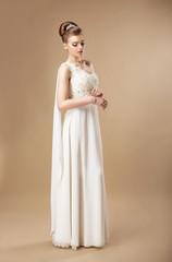 Simplicity. Stylish Woman in Sleeveless Dress