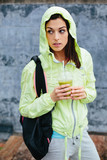 Fitness girl with detox nutrition drink poster