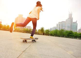 skateboarding woman at city