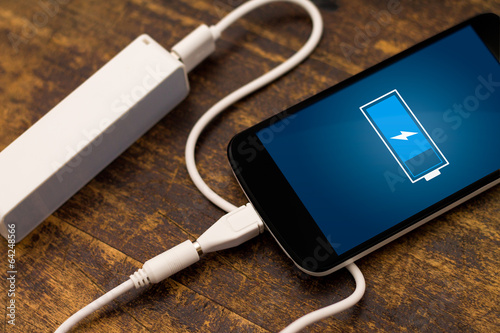 Phone charging with energy bank. Depth of field on Power bank - 64248566