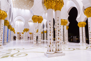 Columns of Grand Mosque in Abu Dhabi at night, UAE