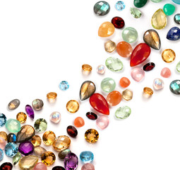 Bright real semiprecious and precious gems on white background.