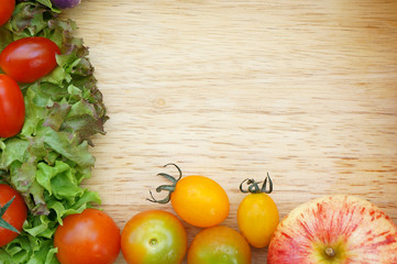 Healthy Organic Vegetables on a Wooden Background. Frame Design