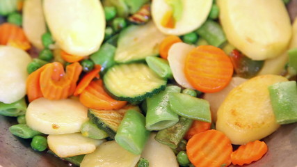 Panning over vegetable mix on frying pan