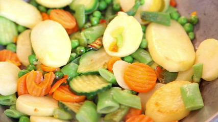 Closeup of frying vegetable mix with selective focus
