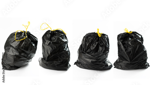 Quatto borse di rifiuti in fila - 64252727