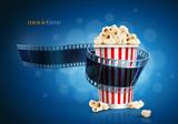 Fototapeta Camera film strip and popcorn.