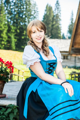 Blonde Woman in traditional austrian clothes
