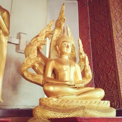 golden image of buddha sitting