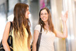 Two young girls shopping in a mall