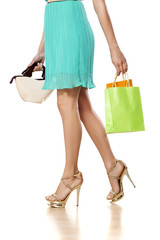 pretty female legs and a couple of shopping bags