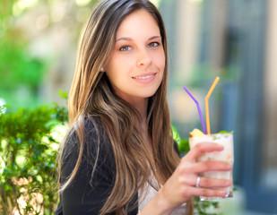 Beautiful woman having a drink