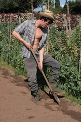 farmer guy working with shovel