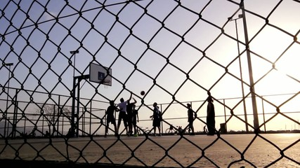 Basketball Match In The Sunset.