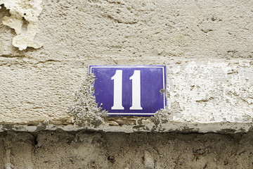 Number eleven on a wall, detail of a number of information