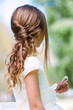 Detail of girl's communion hairstyle.