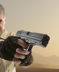 Man's hand holding gun