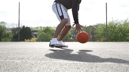 Male basketball player dribbling the ball skilfully