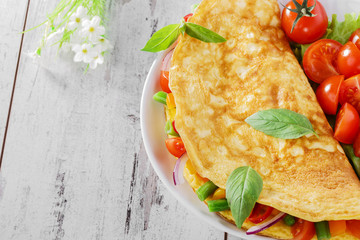 omelet with vegetables and cherry tomatoes