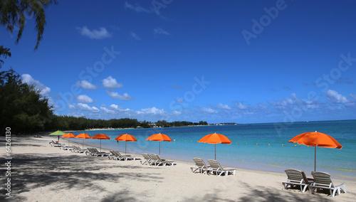 Parasols on Mont-Choisy beach, Mauritius island - 64261130