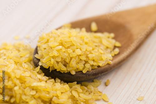 bulgur wheat in wooden spoon