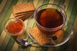 Black tea with apricot jam and pastries
