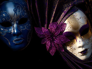two mysterious Venetian mask on a black background