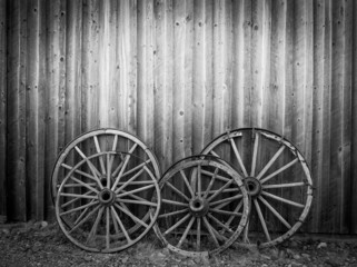Old west, old broken wood wheels with empty place for your text