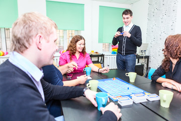 Young adults spending time at exciting guessing game