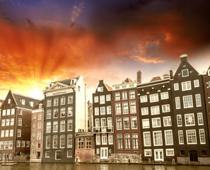 Amsterdam. Beautiful view of classic buildings with colourful sk