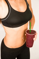Slender Female Torso Tanned Toned Body Blended Fruit Smoothie