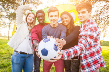 Teenage Friends Holding Brazilian Flag and Soccer Ball