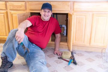 Plumber in kitchen