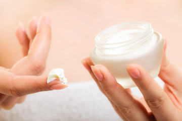 Skin care. Moisturizing cream in female hands