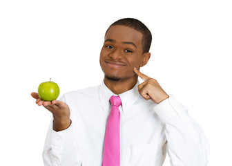 Young happy man offering yummy apple