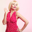 Portrait girl in blond wig and retro red dress. Vintage.