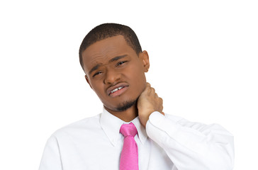 Young man having Neck pain after long hours working day