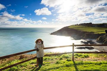 coastline atlantic coast County Cork, Ireland. Woman walking