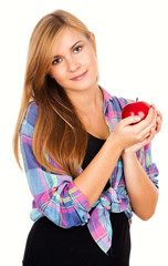 beautiful teen woman smiling, holding red apple