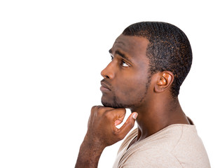 Side view headshot young man daydreaming, white background