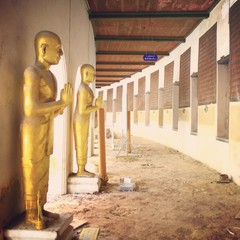 golden image ofbuddha stand in stoop