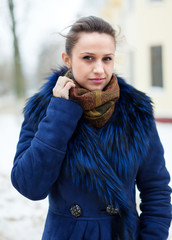 woman in coat  at wintry street
