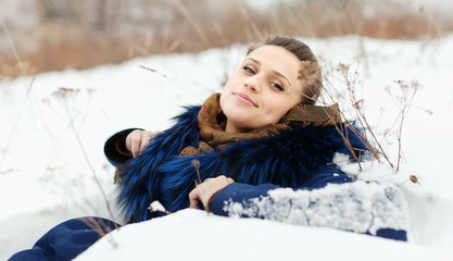 Girl  lying on snow  i